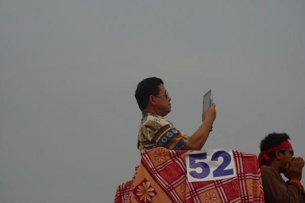 guy taking a video of himself riding an elephant in the parade, haha!